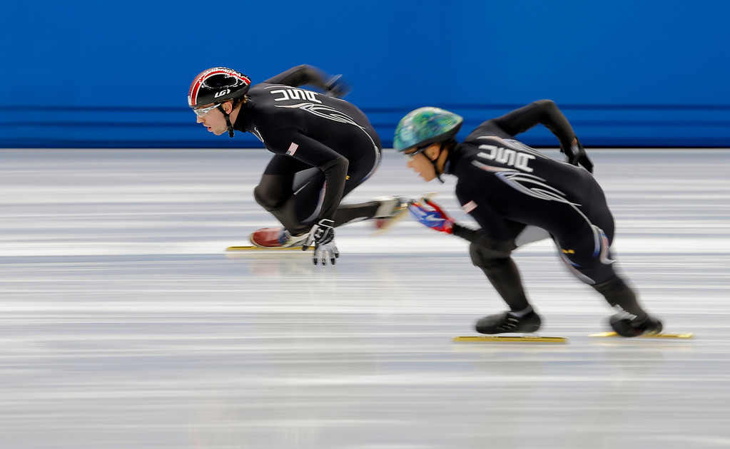 . Christopher Creveling of the U.S., left, practices during a short track speedskating training session at the Iceberg Skating Palace ahead of the 2014 Winter Olympics, Tuesday, Feb. 4, 2014, in Sochi, Russia. (AP Photo/Vadim Ghirda)