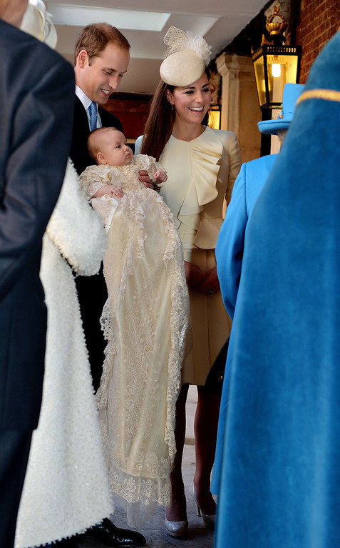 . Britain\'s Prince William, Duke of Cambridge and his wife Catherine, Duchess of Cambridge, arrive with their son Prince George of Cambridge at Chapel Royal in St James\'s Palace in central London on October 23, 2013, ahead of the christening of the three month-old prince.  AFP PHOTO/POOL/JOHN STILLWELL/AFP/Getty Images
