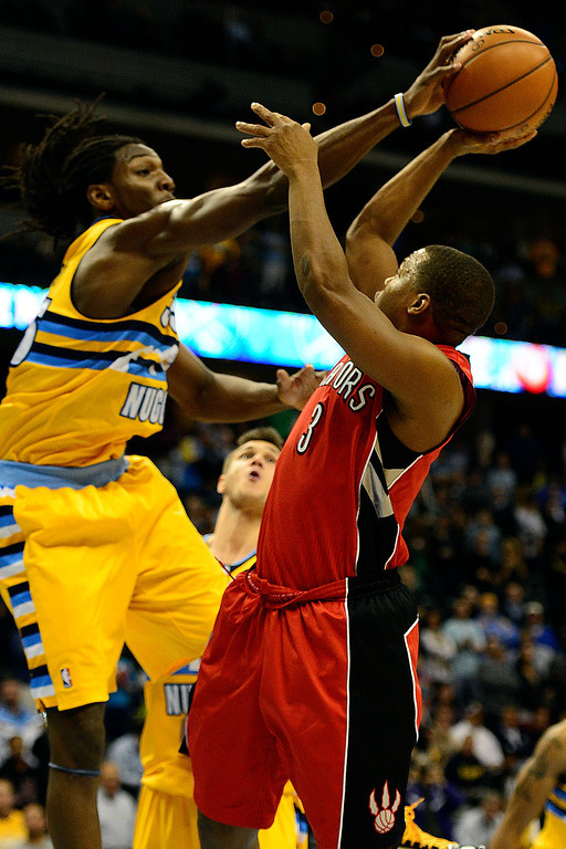 . Denver Nuggets small forward Kenneth Faried (35) blocks a shot by Toronto Raptors point guard Kyle Lowry (3) during the second half of the Nuggets\' 113-110 win at the Pepsi Center on Monday, December 3, 2012. AAron Ontiveroz, The Denver Post