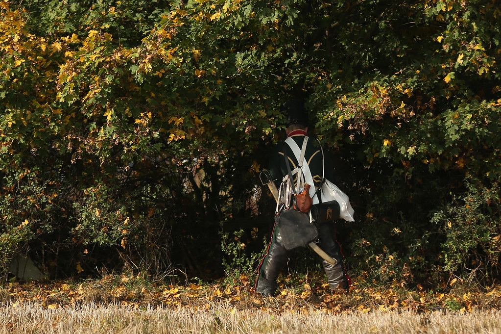 . A historical society enthusiast in the role of a French artillery soldier fighting under Napoleon relieves himself before re-enacting The Battle of Nations on its 200th anniversary on October 20, 2013 near Leipzig, Germany.  (Photo by Sean Gallup/Getty Images)