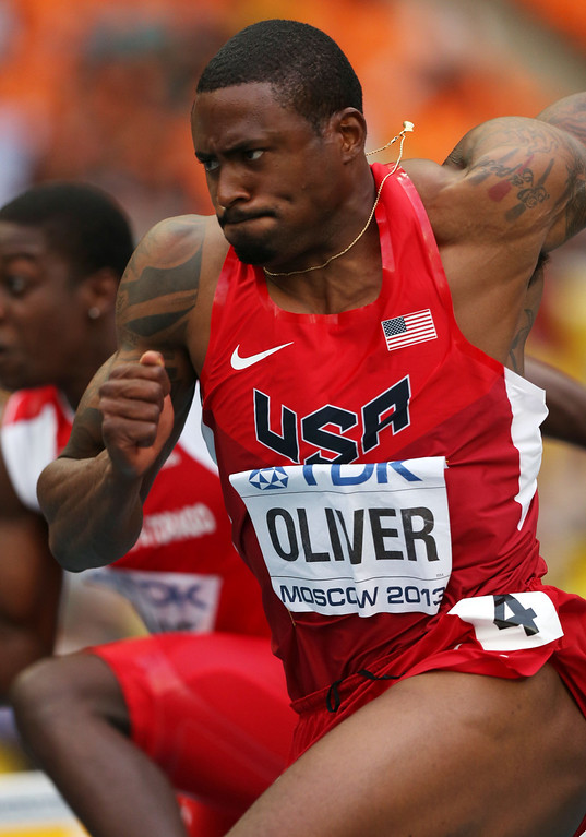 . US\'s David Oliver competes in the men\'s 110 meters hurdles semi-final at the 2013 IAAF World Championships at the Luzhniki stadium in Moscow on August 12, 2013.  AFP PHOTO / ADRIAN DENNISADRIAN DENNIS/AFP/Getty Images