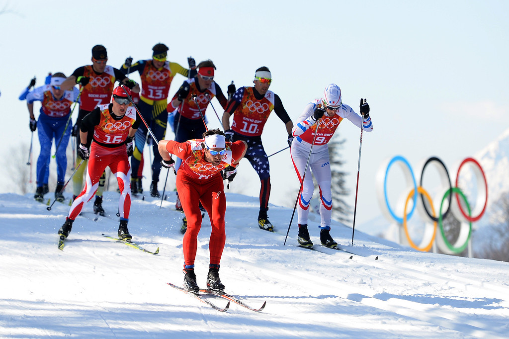 . Cross country skiers competes on the first leg of the Cross Country Men\'s 4 x 10 km Relay during day nine of the Sochi 2014 Winter Olympics at Laura Cross-country Ski & Biathlon Center on February 16, 2014 in Sochi, Russia.  (Photo by Harry How/Getty Images)