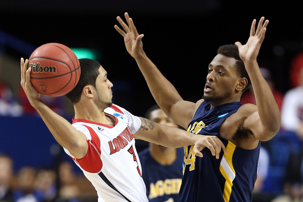 . LEXINGTON, KY - MARCH 21:  Peyton Siva #3 of the Louisville Cardinals looks to pass the ball against Bruce Beckford #34 of the North Carolina A&T Aggies during the second round of the 2013 NCAA Men\'s Basketball Tournament at the Rupp Arena on March 21, 2013 in Lexington, Kentucky.  (Photo by Andy Lyons/Getty Images)