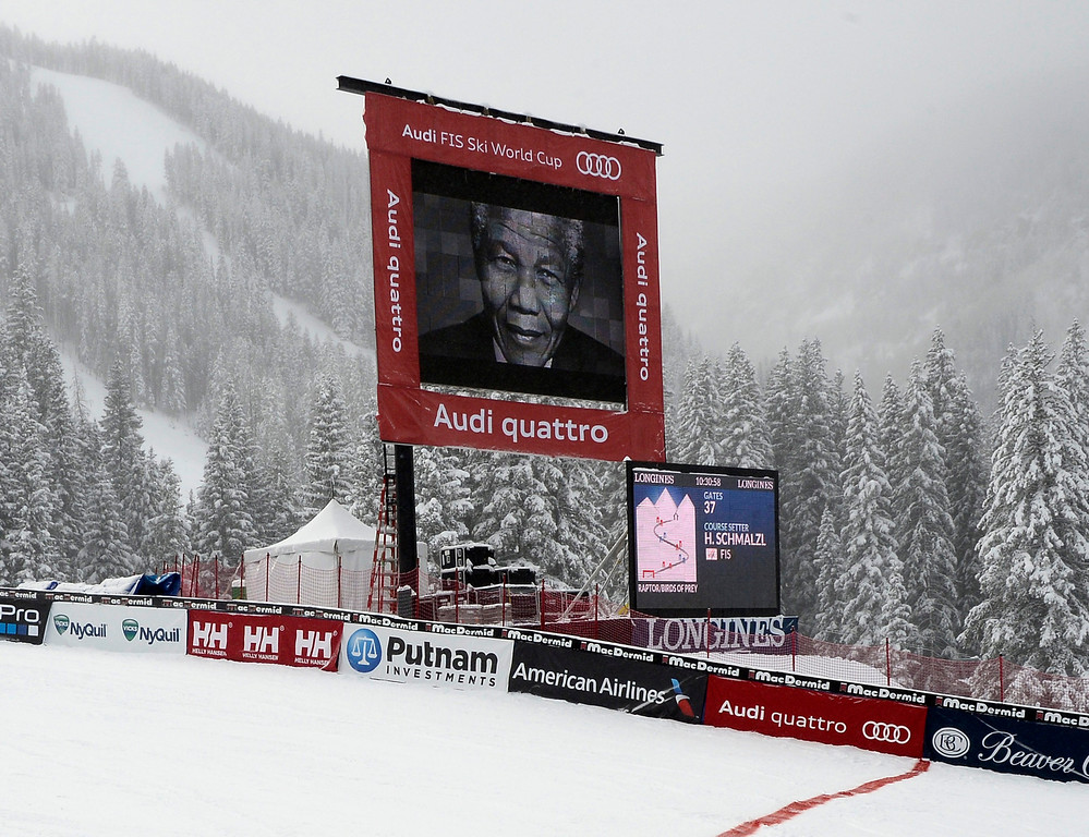 . A moment of silence is observed for the late South African President Nelson Mandela as his portrait is displayed on the large screen in the finish area before the start in the men\'s Downhill at the FIS World Cup Alpine Skiing in Beaver Creek, Colorado, USA, 06 December 2013.  EPA/JOHN G. MABANGLO