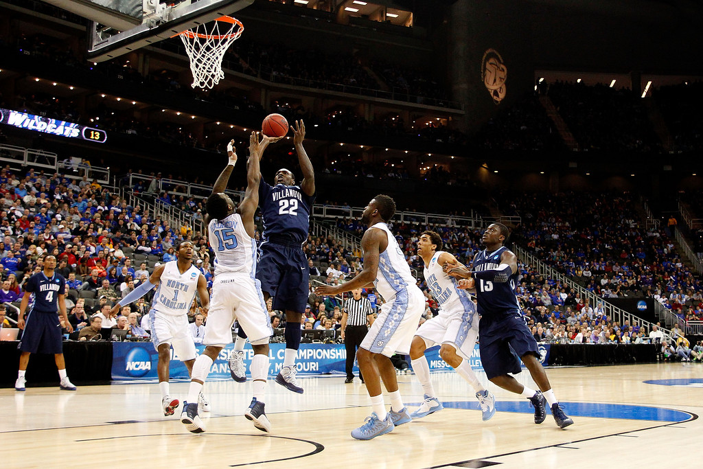 . KANSAS CITY, MO - MARCH 22: JayVaughn Pinkston #22 of the Villanova Wildcats shoots against P.J. Hairston #15 of the North Carolina Tar Heels in the first half during the second round of the 2013 NCAA Men\'s Basketball Tournament at the Sprint Center on March 22, 2013 in Kansas City, Missouri.  (Photo by Ed Zurga/Getty Images)