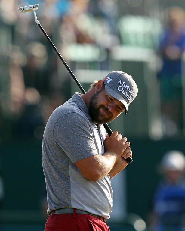 . US golfer Ryan Moore reacts to missing a putt on the 18th green during the third round of the 2013 British Open Golf Championship at Muirfield golf course at Gullane in Scotland on July 20, 2013 . PETER MUHLY/AFP/Getty Images