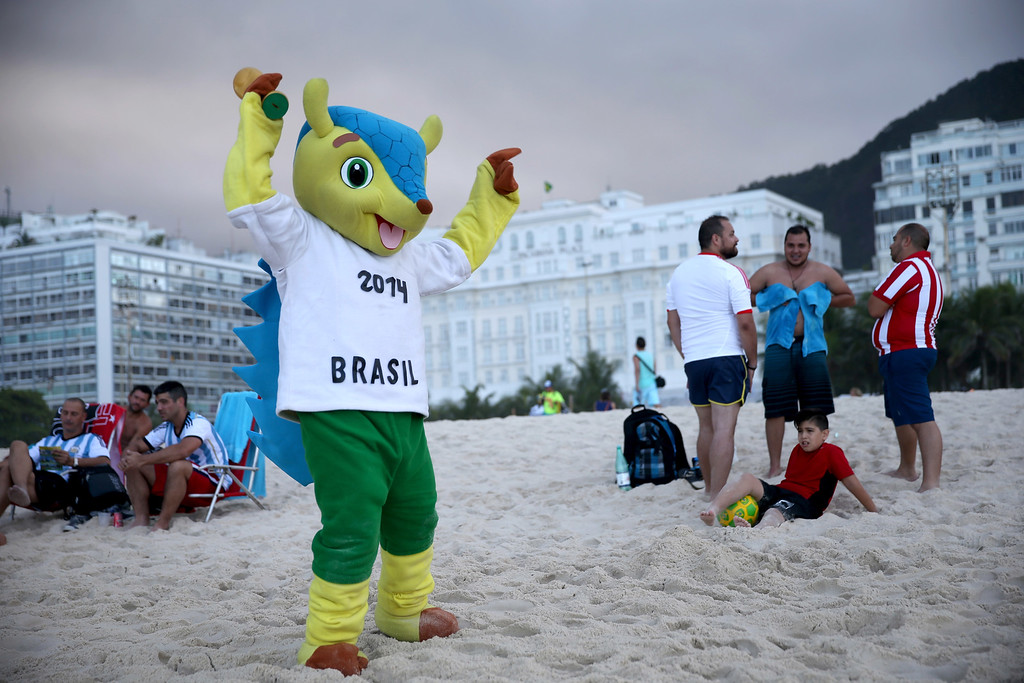 . Paul Sota wears a suit that looks like the FIFA mascot as he visits Copacabana beach while waiting for the start of the 2014 FIFA World Cup on June 11, 2014 in Rio de Janeiro, Brazil.   Brazil continues to prepare to host the World Cup which starts on June 12th and runs through July 13th.  (Photo by Joe Raedle/Getty Images)