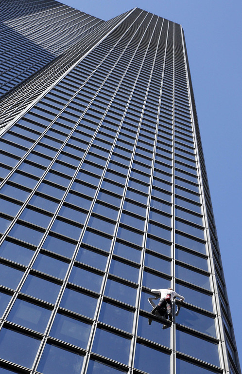 . Alain Robert, the French urban climber dubbed Spiderman, climbs the Total company\'s headquarters, a 186-meter high skyscraper, at the business district of La Defense, near Paris, on March 20, 2014.  AFP PHOTO / FRANCOIS GUILLOT/AFP/Getty Images