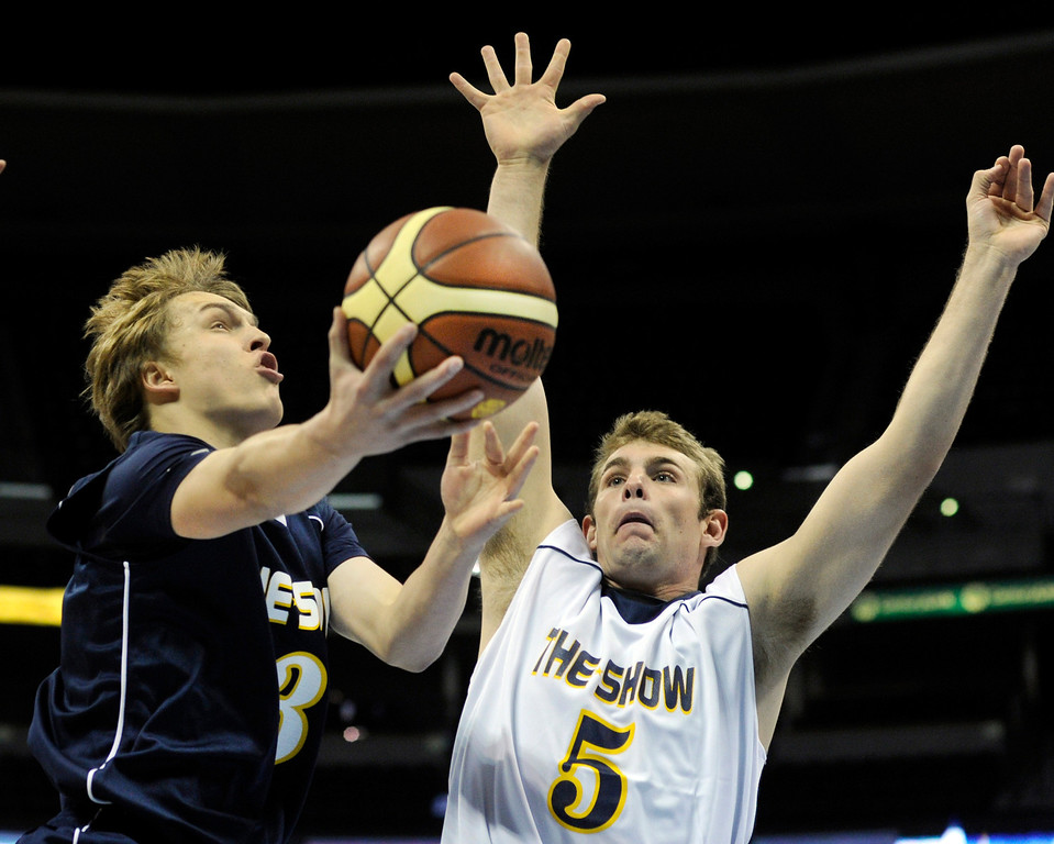 . DENVER, CO. - APRIL 6: Akron junior Brady Baer (3) tried to get past Shining Mountain defender Colin Cantwell (5) in the first half. Team Blue defeated Team White 93-77 in the annual exhibition of All-Star prep basketball talent called The Show at the Pepsi Center Saturday night, April 6, 2013. Photo By Karl Gehring/The Denver Post)