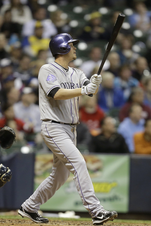 . MILWAUKEE, WI - APRIL 3:  Reid Brignac #16 of the Colorado Rockies doubles off the left field wall, scoring Jordan Pacheco (not pictured) in the top of the fifth inning against the Milwaukee Brewers at Miller Park on April 3, 2013 in Milwaukee, Wisconsin. (Photo by Mike McGinnis/Getty Images)