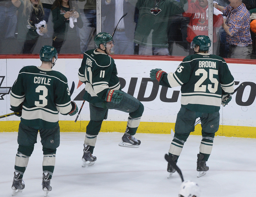 . Zach Parise, center, celebrated his game winning goal with teammates Charlie Coyle and Jonas Brodin in the third period.  (Photo by Karl Gehring/The Denver Post)