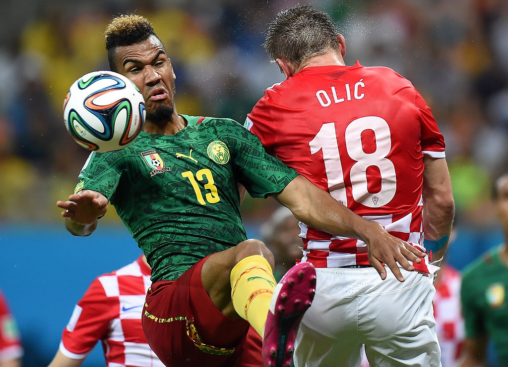 . Cameroon\'s forward Eric Maxim Choupo-Moting (L) challenges Croatia\'s forward Ivica Olic for the ball during the Group A football match between Cameroon and Croatia at The Amazonia Arena in Manaus on June 18, 2014, during the 2014 FIFA World Cup.  JAVIER SORIANO/AFP/Getty Images