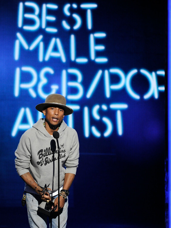 . Pharrell Williams accepts the awards for best male R&B/Pop artist at the BET Awards at the Nokia Theatre on Sunday, June 29, 2014, in Los Angeles. (Photo by Chris Pizzello/Invision/AP)