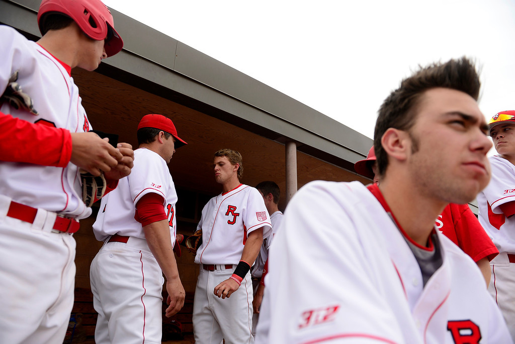 . PARKER, CO - APRIL 29: Regis Jesuit shortstop Brody Weiss speaks with assistant coach Bryan Cash as teammates watch the action during the team\'s final home game. Weiss is the son of Colorado Rockies manager Walt Weiss. (Photo by AAron Ontiveroz/The Denver Post)