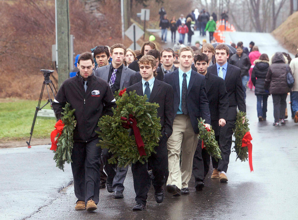 . Members of the Philadelphia Little Flyers hockey team arrive with wreaths to place at a memorial for the shooting victims near Sandy Hook Elementary School in Newtown, Connecticut December 16, 2012. REUTERS/ Michelle McLoughlin