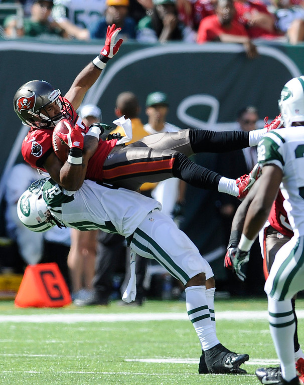 . New York Jets defensive back Ellis Lankster (21) brings down Tampa Bay Buccaneers\' Eric Page during a punt return in the second half of an NFL football game, Sunday, Sept. 8, 2013, in East Rutherford, N.J. (AP Photo/Bill Kostroun)