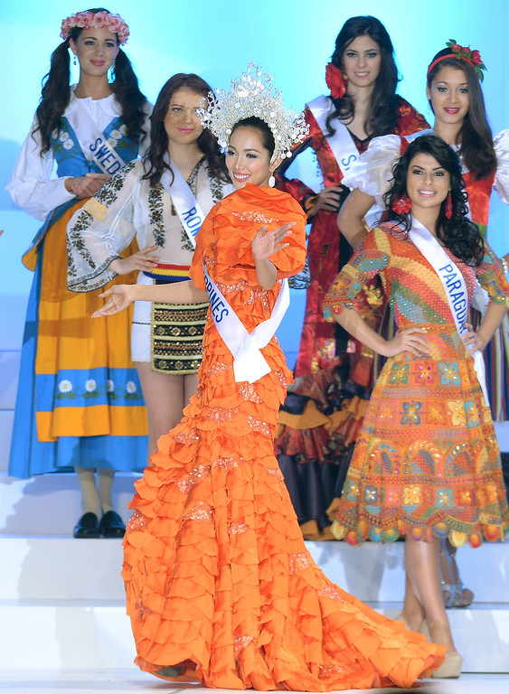 . Wearing national dress, Bea Rose Santiago (C) of the Philippines walks before representatives from other countries during the Miss International Beauty Pageant in Tokyo on December 17, 2013. The 23-year-old student from the Philippines won the crown at this year\'s Miss International. TORU YAMANAKA/AFP/Getty Images