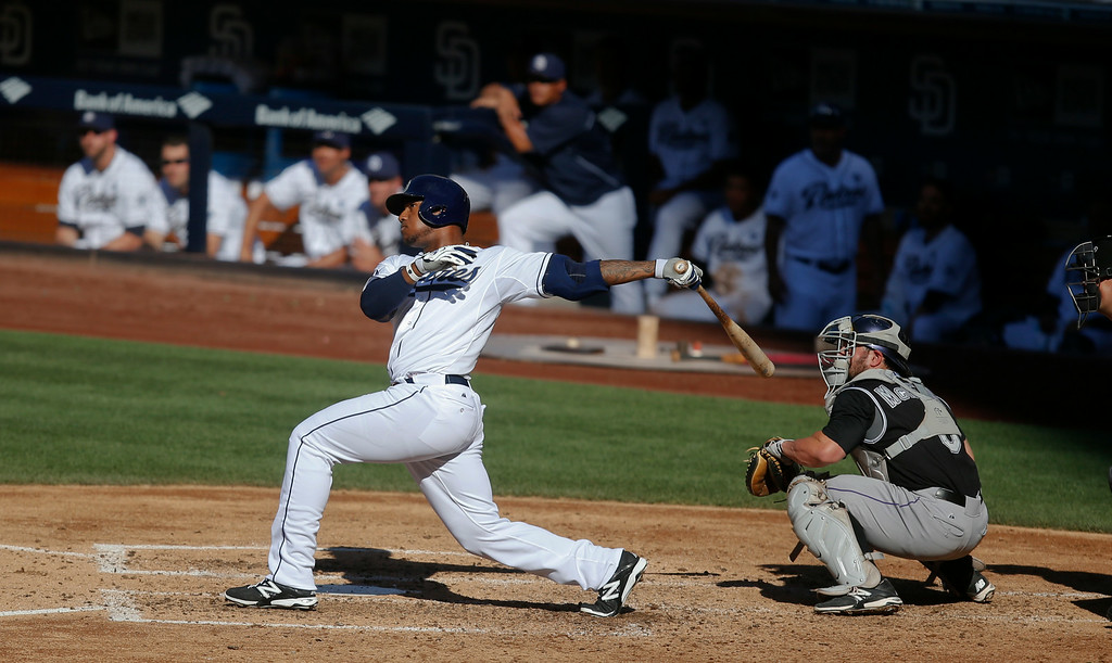 . San Diego Padres\' Rymer Liriano admires his 427-foot two run homer, the first of his career, in the fourth inning of a baseball game against the Colorado Rockies Wednesday, Aug. 13, 2014, in San Diego. (AP Photo/Lenny Ignelzi)