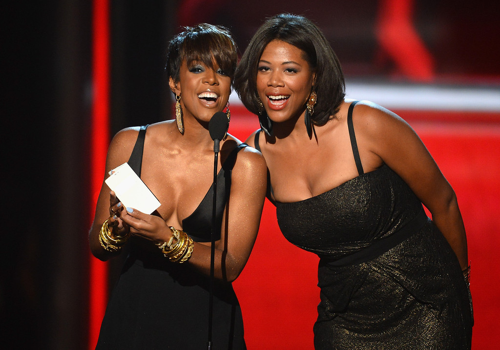 . Singer Kelly Rowland (L) and news personality Shaneen Quarles speak onstage during the 2014 Billboard Music Awards at the MGM Grand Garden Arena on May 18, 2014 in Las Vegas, Nevada.  (Photo by Ethan Miller/Getty Images)