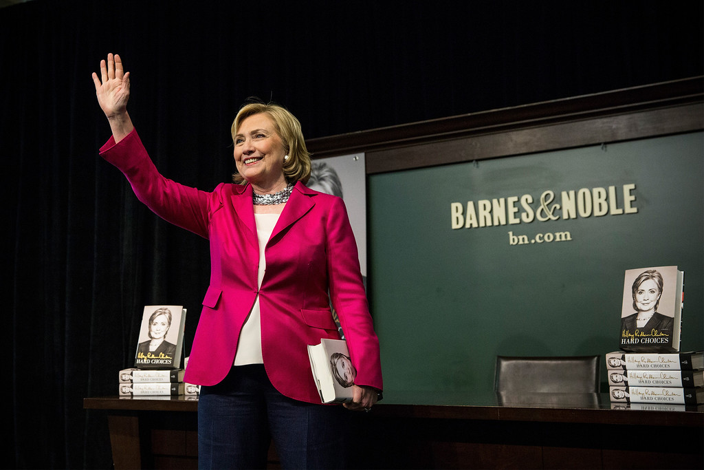 """. Former Secretary of State Hillary Clinton speaks to a crowd during a book signing for her new book, \""""Hard Choices\"""" at a Barnes & Noble on June 10, 2014 in New York City. (Photo by Andrew Burton/Getty Images)"""