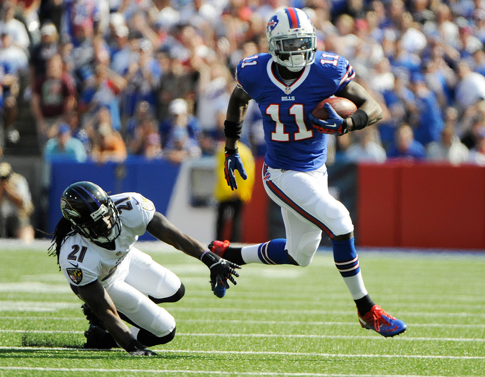 . Buffalo Bills wide receiver T.J. Graham (11) runs past Baltimore Ravens cornerback Lardarius Webb (21) during the first half of an NFL football game on Sunday, Sept. 29, 2013, in Orchard Park, N.Y. (AP Photo/Gary Wiepert)