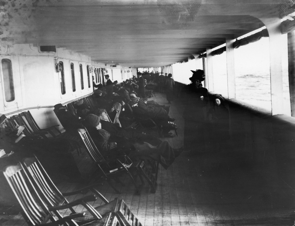 . Passengers relax in deck chairs on the saloon deck of the Cunard liner Lusitania, June 1912.  (Photo by Topical Press Agency/Hulton Archive/Getty Images)