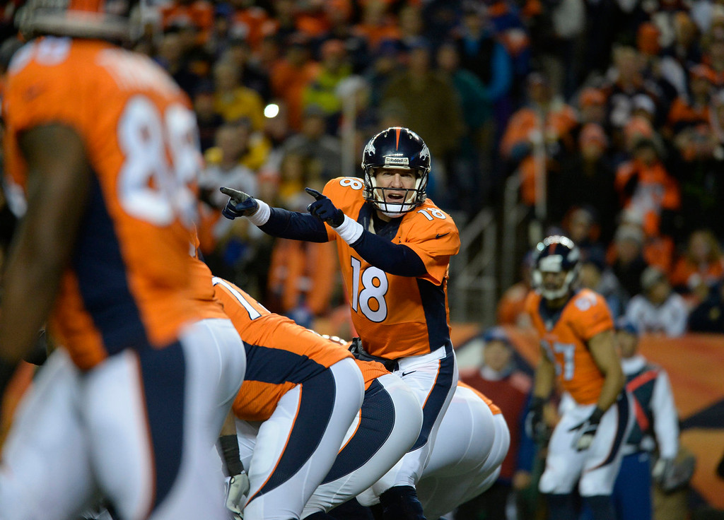 . Denver Broncos quarterback Peyton Manning (18) yells commands from the line in the first quarter. The Denver Broncos take on the Kansas City Chiefs at Sports Authority Field at Mile High in Denver on November 17, 2013. (Photo by Tim Rasmussen/The Denver Post)