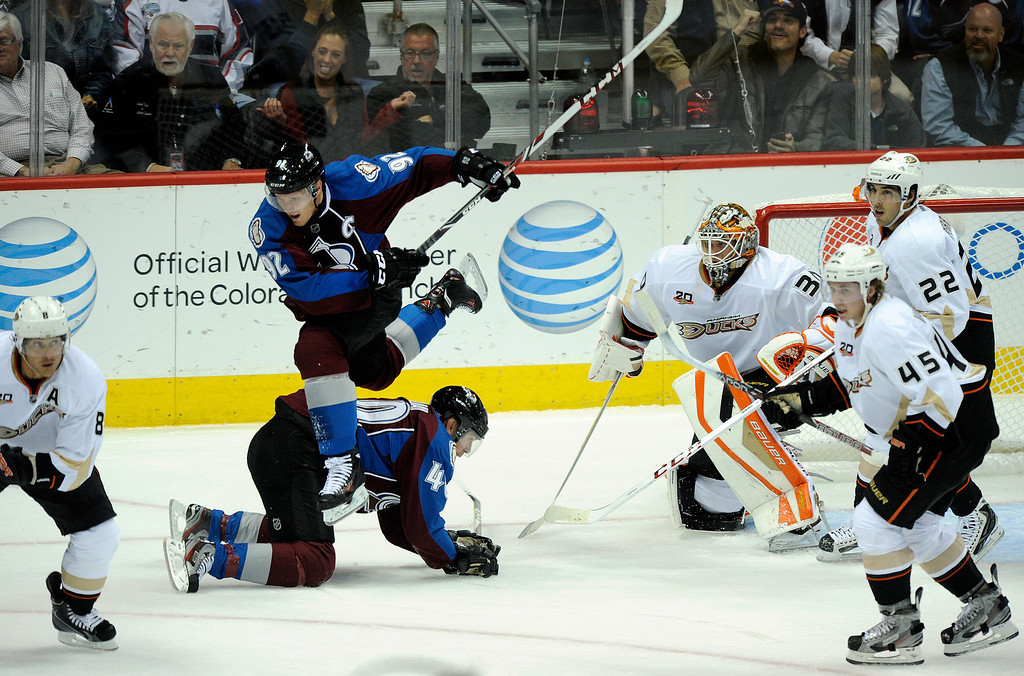 . DENVER, CO. - OCTOBER 02: Avalanche wing Gabriel Landeskog (92) leapt off teammate Alex Tanguay (40) the first period. The Colorado Avalanche hosted the Anaheim Ducks at the Pepsi Center Wednesday night, October 2, 2013. Photo By Karl Gehring/The Denver Post