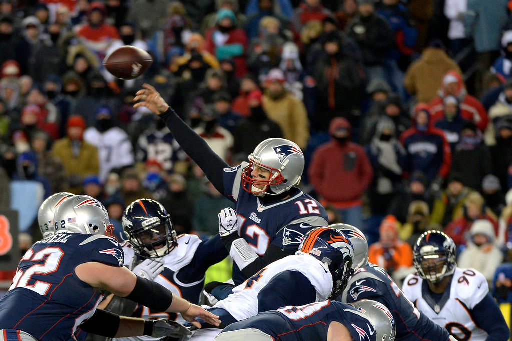 . Quarterback Tom Brady #12 of the New England Patriots passing in traffic against the Denver Broncos at Gillette Stadium in Foxborough MA, November 24, 2013 Denver. (Photo By Joe Amon/The Denver Post)