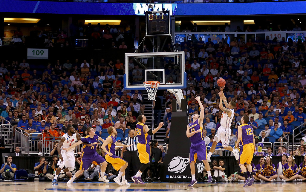 . ORLANDO, FL - MARCH 20:  Scottie Wilbekin #5 of the Florida Gators shoots over Michael Rowley #10 of the Albany Great Danes to end the first half during the second round of the 2014 NCAA Men\'s Basketball Tournament at Amway Center on March 20, 2014 in Orlando, Florida.  (Photo by Mike Ehrmann/Getty Images)