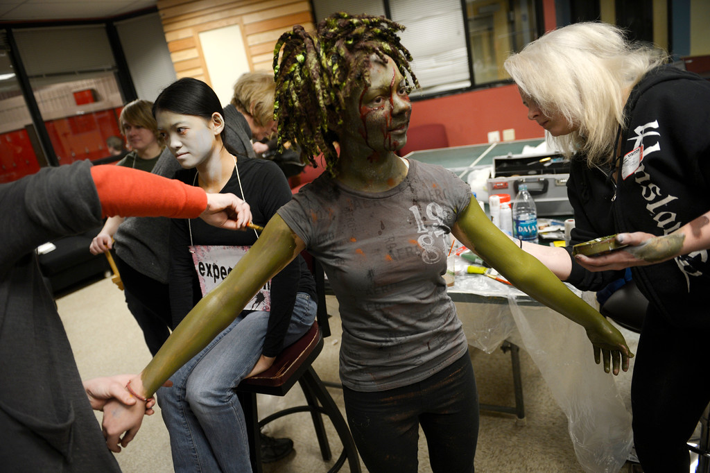 ". BOULDER, CO- FEBRUARY 19:   Kristy Pike, left, and Danica Minor, right, both  make-up artists with Theatrical Costumes Etc., apply ""Zombie\"" make up to zombie Sydney McVicker, 14.   With the help of a professional videographer, Fairview High School students produced a zombie video to advertise an Awareness Drive in Boulder Valley schools designed to bring attention to a variety of mental health and wellness issues.  Students were made to look like zombies by make-up artists from Theatrical Costumes, Etc. (Photo By Helen H. Richardson/ The Denver Post)"