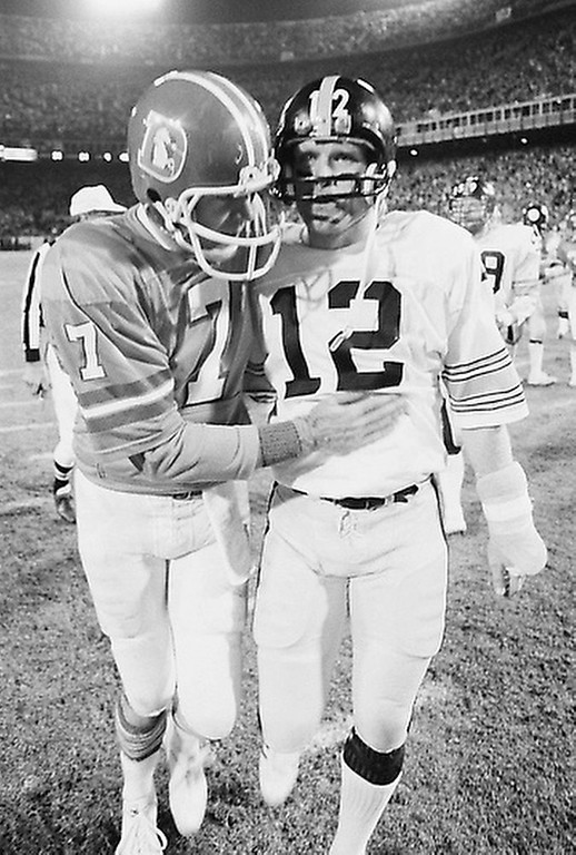 . Denver Broncos quarterback Craig Morton, left, pats stomach of Pittsburgh Steelers quarterback Terry Bradshaw after AFC Game, Saturday, Dec. 24, 1977 at Denver\'s Mile High Stadium. Morton and the Broncos beat the Steelers, 34-21, to win their first Playoff Game in their NFL history. (AP Photo)