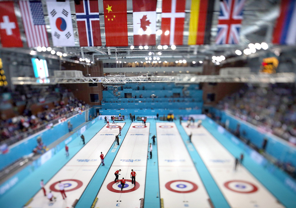 . A picture taken with a tilt-shift lens shows the team of Great Britain (2-L) during the Round Robin match between Germany and Great Britain of the Men\'s Curling Competition in the Ice Cube Curling Center at the Sochi 2014 Olympic Games, Sochi, Russia, on Feb. 11, 2014.  EPA/TATYANA ZENKOVICH