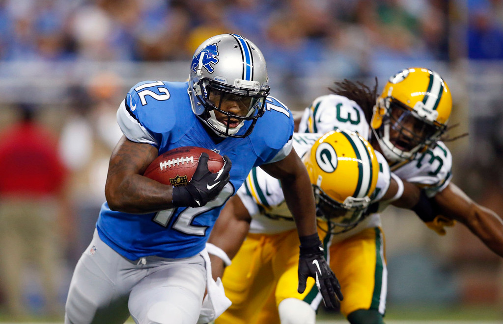 . Detroit Lions wide receiver Jeremy Ross (12) pulls away from Green Bay Packers cornerback Jarrett Bush (24) and cornerback Davon House (31) during the first quarter of an NFL football game at Ford Field in Detroit, Thursday, Nov. 28, 2013. (AP Photo/Rick Osentoski)