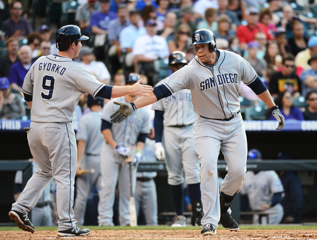. Denver, CO. - June 08: Kyle Blanks of San Diego Padres (88) celebrate his 2 run home run with Jedd Gyorko (9) in the 4th inning of the game against Colorado Rockies at Coors Field. Denver, Colorado. June 8, 2013.  (Photo By Hyoung Chang/The Denver Post)
