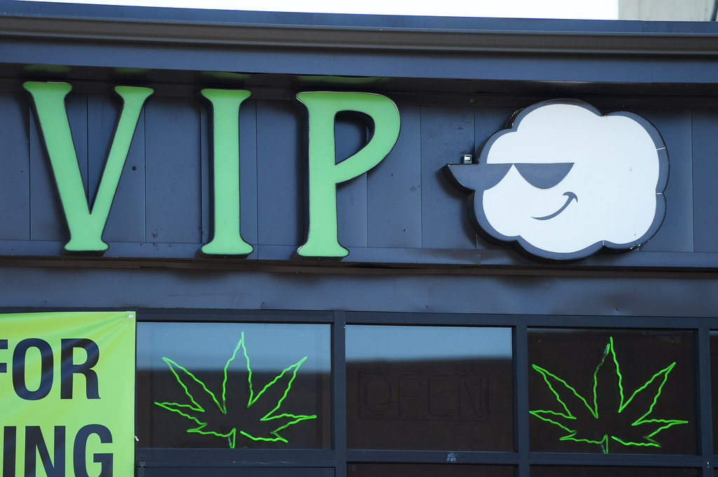 . Drug Enforcement Agency officials raid VIP Cannabis, located at 2949 W. Alameda Ave., April 30, 2014. The marijuana dispensary was previously raided in November 2013. (Photo by RJ Sangosti/The Denver Post)