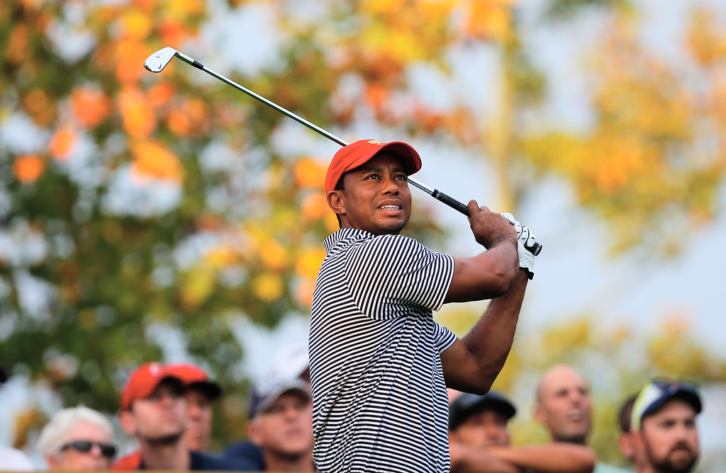 . DUBLIN, OH - OCTOBER 04:  Tiger Woods of the U.S. Team hits his tee shot on the eighth hole during the Day Two Foursome Matches at the Muirfield Village Golf Club on October 4, 2013  in Dublin, Ohio.  (Photo by Matt Sullivan/Getty Images)