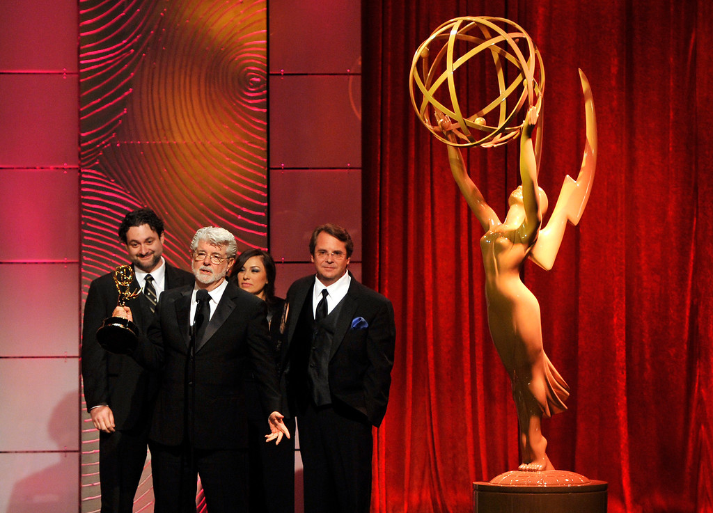 ". George Lucas, second from left, and the crew of ""Star Wars: The Clone Wars\"" accept the award for outstanding special class animated program at the 40th Annual Daytime Emmy Awards on Sunday, June 16, 2013, in Beverly Hills, Calif. (Photo by Chris Pizzello/Invision/AP)"