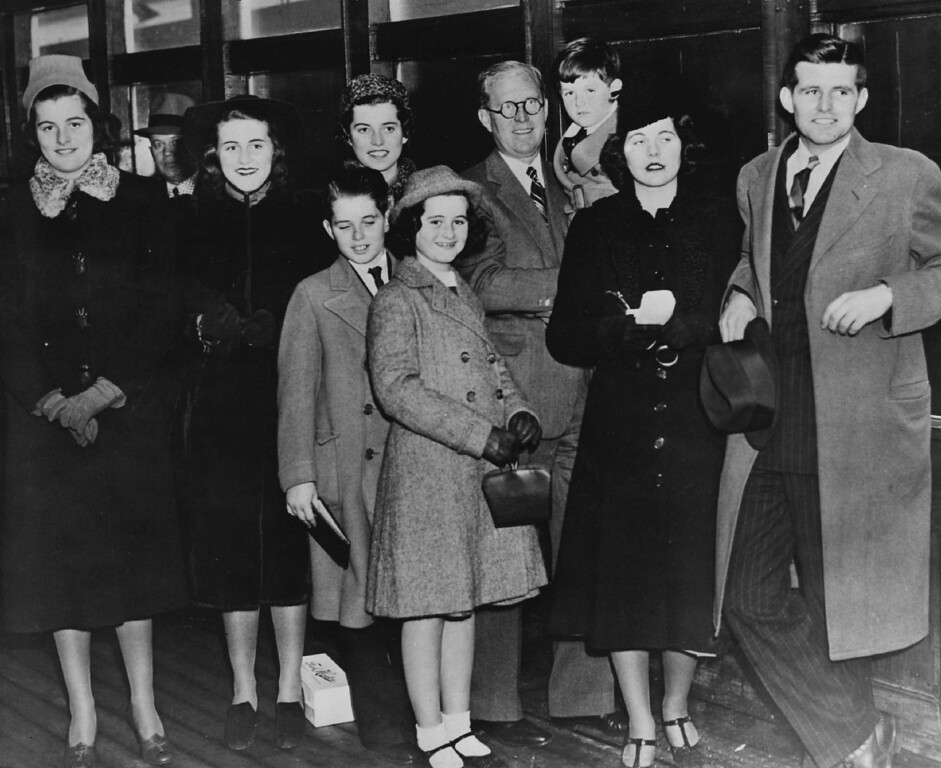 . Ambassador Joseph Kennedy, center, holds Edward Kennedy for a photo with family members, from left:  Patricia, Kathleen, Eunice Rosemary and Joseph, Jr. In front are Robert and Jeanne. Denver Post file