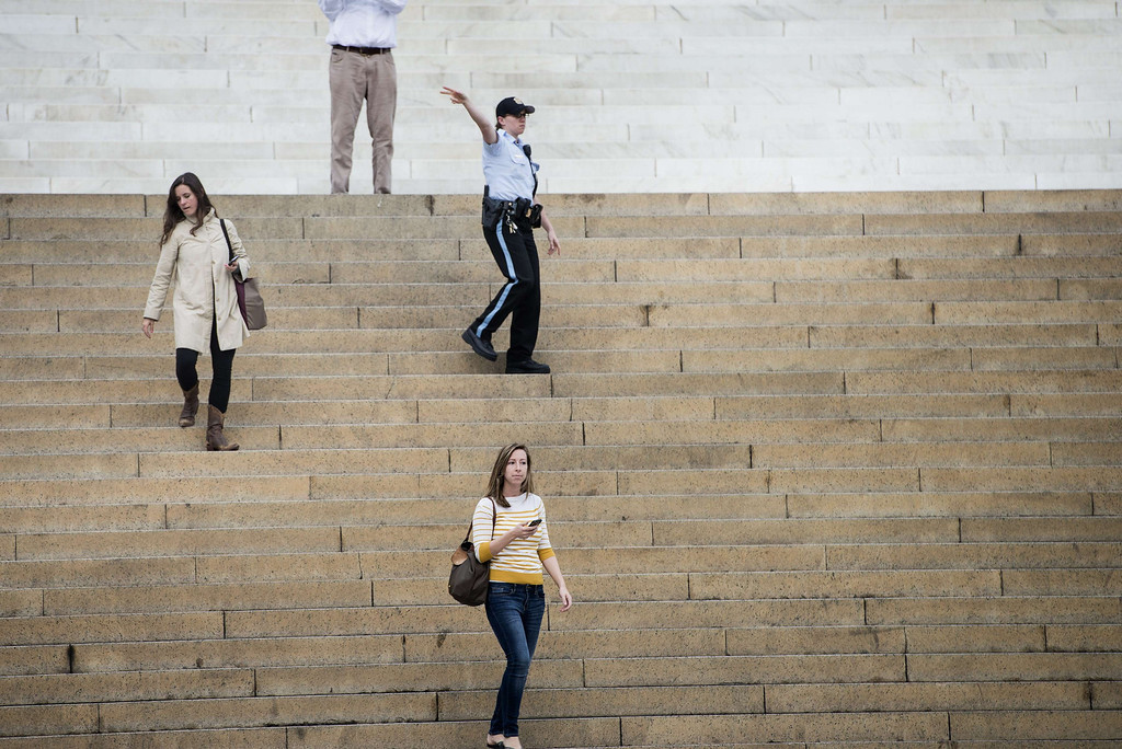 . A US Park Police Officer directs people away after closing the Lincoln Memorial on the National Mall October 1, 2013 in Washington, DC.  AFP PHOTO/Brendan SMIALOWSKI/AFP/Getty Images