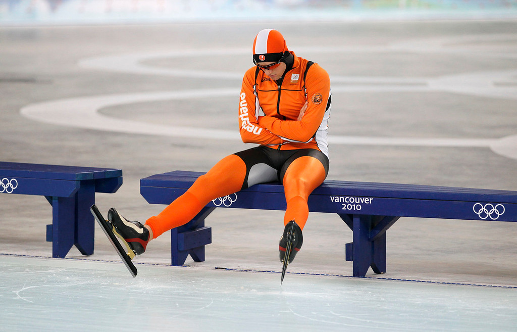 . Simon Kuipers of The Netherlands waits for the ice preparation to finish during the first of two heats in the men\'s 500 meters race at the Richmond Olympic Oval at the Vancouver 2010 Olympics in Vancouver, British Columbia, Monday, Feb. 15, 2010. Problems with the machine that resurfaces the ice in between races at the speedskating venue have forced a delay during the men\'s 500 meters. Two are used to clean the ice, but the Richmond Olympic Oval was down to just one Monday because of problems with the other. (AP Photo/Kevin Frayer)