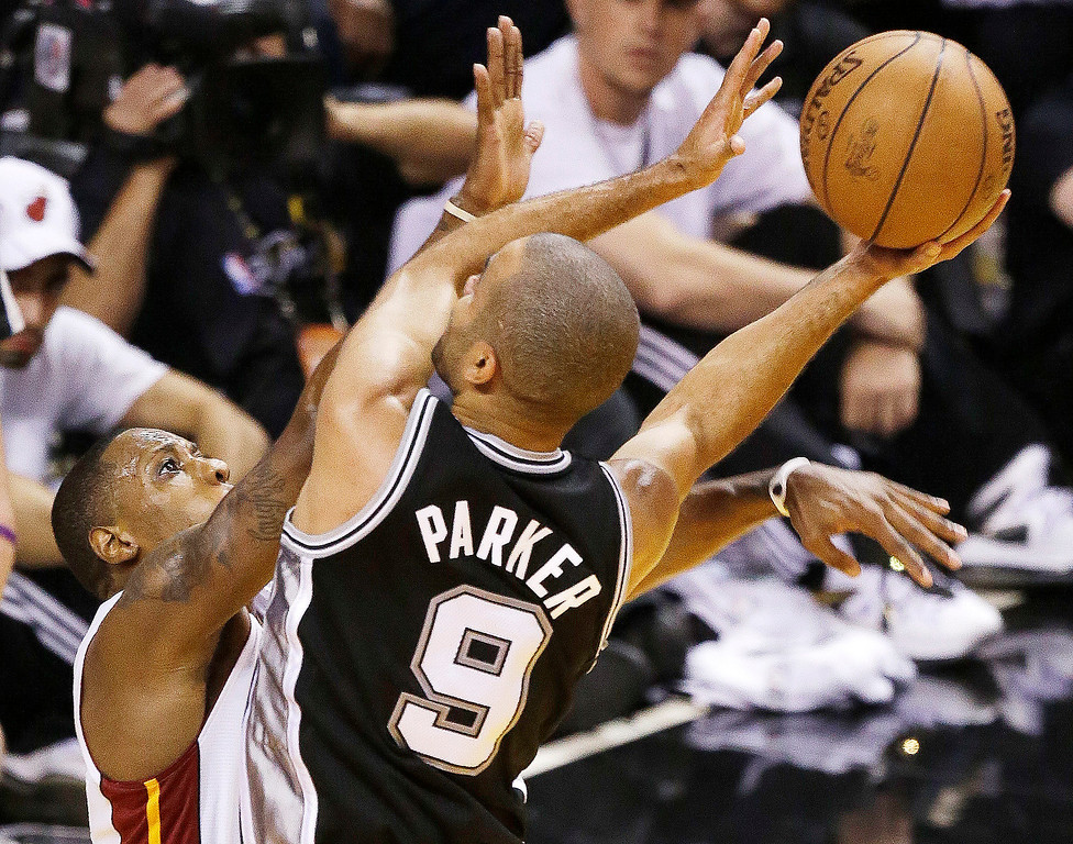 . Miami Heat point guard Mario Chalmers (15) defends against San Antonio Spurs point guard Tony Parker (9) during the second half of Game 6 of the NBA Finals basketball game, Tuesday, June 18, 2013 in Miami. (AP Photo/Wilfredo Lee)