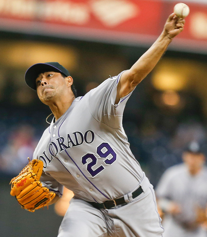 . Colorado Rockies starting pitcher Jorge De La Rosa works against the San Diego Padres in the first inning of a baseball game Wednesday, April 16, 2014, in San Diego.  (AP Photo/Lenny Ignelzi)