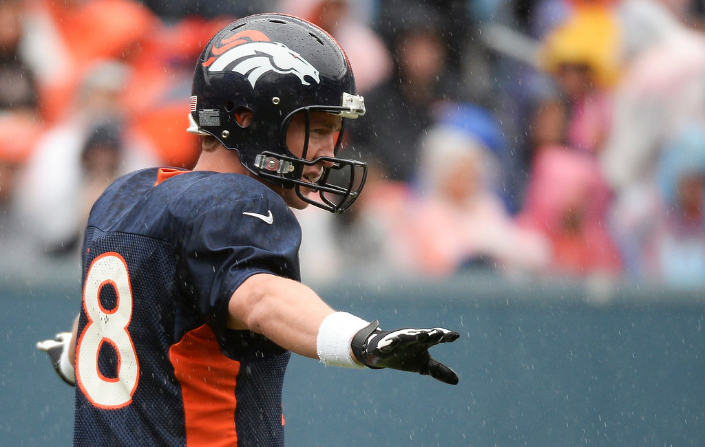 . Denver Broncos quarterback Peyton Manning (18) calls out the play as he wears the glove during a rain day on day six of the Denver Broncos 2014 training camp July 30, 2014 at Sports Authority Field at Mile High Stadium.  (Photo by John Leyba/The Denver Post)