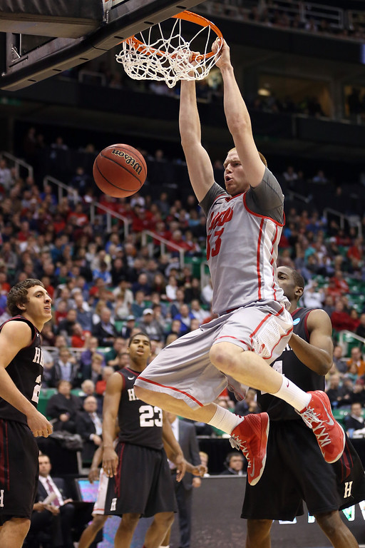 . SALT LAKE CITY, UT - MARCH 21:  Alex Kirk #53 of the New Mexico Lobos dunks the ball in the second half while taking on the Harvard Crimson during the second round of the 2013 NCAA Men\'s Basketball Tournament at EnergySolutions Arena on March 21, 2013 in Salt Lake City, Utah.  (Photo by Streeter Lecka/Getty Images)