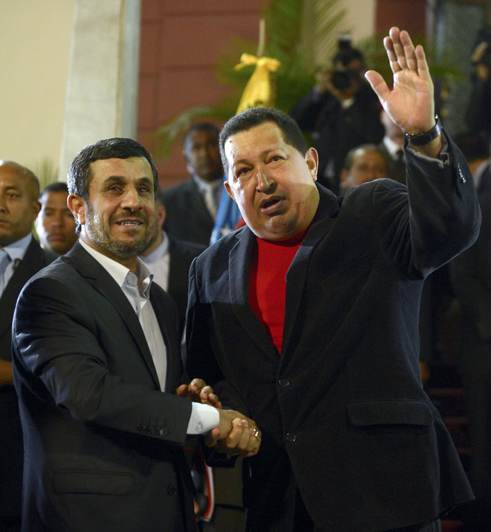 . Venezuelan President Hugo Chavez (R) and Iran\'s President Mahmoud Ahmadinejad shake hands during a meeting at Miraflores presidential palace in Caracas on June 22, 2012. President Hugo Chavez passed away on March 5, 2013 in Caracas after a long fight with cancer, Venezuelan Vice President Nicolas Maduro announced. JUAN BARRETO/AFP/Getty Images