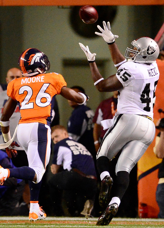 . Oakland Raiders fullback Marcel Reece (45) makes a touchdown catch int eh third quarter. The Denver Broncos took on the Oakland Raiders at Sports Authority Field at Mile High in Denver on September 23, 2013. (Photo by AAron Ontiveroz/The Denver Post)