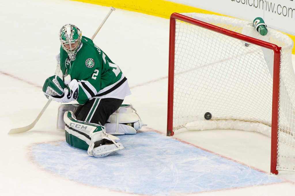 . DALLAS, TX - NOVEMBER 1:  Kari Lehtonen #32 of the Dallas Stars reacts as a shot by Paul Stastny #26 of the Colorado Avalanche goes into the net to win the game in overtime on November 1, 2013 at the American Airlines Center in Dallas, Texas.  (Photo by Cooper Neill/Getty Images)