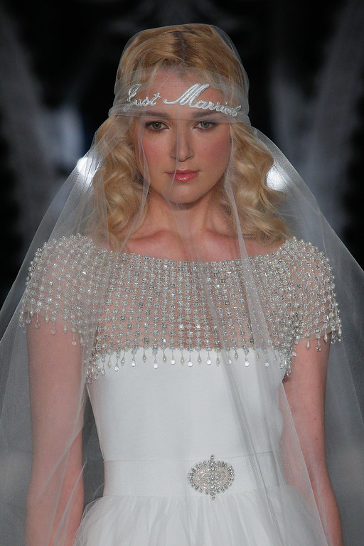 . A model walks the runway during the Reem Acra 2014 Bridal Spring/Summer collection show on April 20, 2013 in New York City.  (Photo by JP Yim/Getty Images)