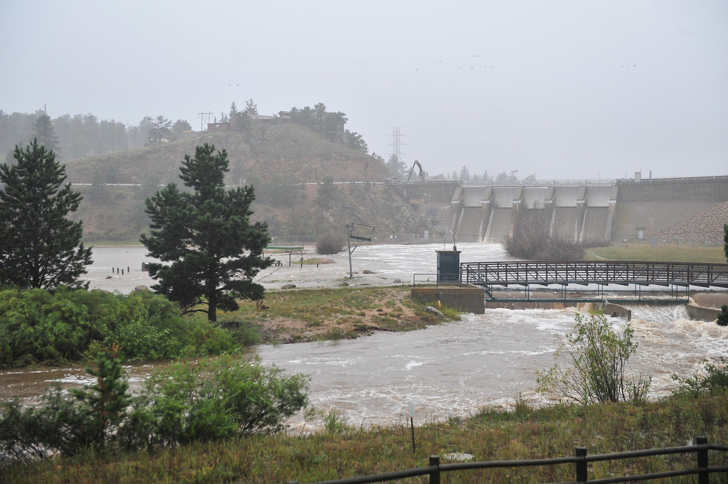 . With the Olympus Dam floodgates open, the Big Thompson River inundates Wapiti Meadows. The increased flow may have kept Estes Park from even more flooding, but led to the collapse of a section of US 34 above Drake. Walt Hester/Estes Park Trail-Gazette